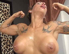 Female muscle cougar Bobbi is giving a hand job and she pushes her client to the point of breaking. He feels up her big tits and gets to worship her biceps - its no wonder that he shoots a huge load of cum all over her biceps and tits.