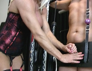 Naked female bodybuilder Ashlee Chambers can be a cruel mistress. However, she can also be quite nice to her slaves. On this day she chooses to give an adoring slave a handjob - while torturing him with bicep fucking and showing off her amazing ripped body. Will she give him the ultimate release? Not yet!