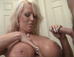 Pornstar Alura Jenson is an amazon and she loves giving handjobs! She kneels in front of her man, begins stroking his cock and doesn't stop until he shoots a big load all over her massive pecs.