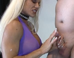 Female bodybuilder, muscle porn star, and fem domme Ashlee Chambers, in high-heeled shoes and panties, is pumping up a man's cock and balls, giving him a hand job until he cums and verbally humiliating him while you look at her muscular pecs, legs, glutes and  biceps, and watch her play with her big clit in close-up.