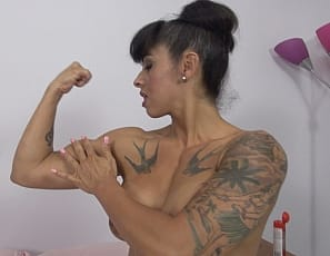 Super hot naked female bodybuilder Bobbi is giving her man a handjob - and loving every minute of it! We're not sure if its her big tits, biceps, tight abs, or her naughty attitude - but we LOVE this girl! Once he cums on her tits and she starts to rub it all over her body we're over the top with appreciation, and we think you will be too.