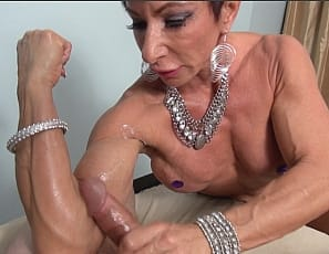 Female muscle porn star and bodybuilder Anna Phoenixxx is giving verbal humiliation and muscle fucking, and getting the mature muscles of her ripped, tattooed abs and vascular pecs, biceps, and legs worshiped while she helps a man  masturbate with a hand job he'll never forget.